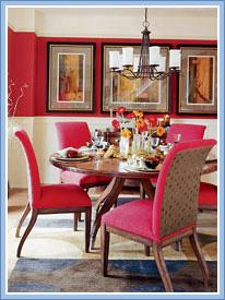 Clean dining room with round table and red chairs on carpet