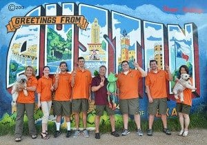 Peace Frog Carpet Cleaning company photo in front of Greetings From Austin mural