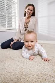 Mom and baby on freshly cleaned carpet, cleaned by Peace Frog Carpet and Tile Cleaning in Austin