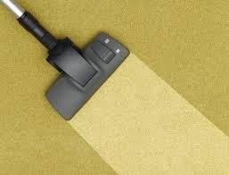 Clean carpet line made by steam cleaner on dirty yellow carpet