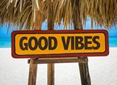 Good Vibes sign in hut on beach