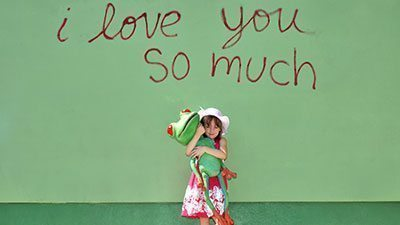 Girl with Peace Frog Carpet Cleaning mascot puppet at Austin's I Love You So Much spot