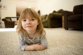 Little girl laying on carpet cleaned with kid friendly organic materials