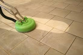 Dirty tile floor in the middle of tile and grout cleaning by Peace Frog Carpet & Tile Cleaning in Austin