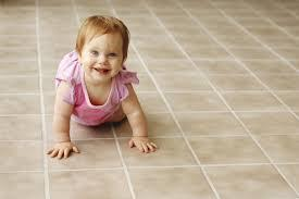 Baby on freshly cleaned tile, cleaned by Peace Frog Carpet and Tile Cleaning in Austin