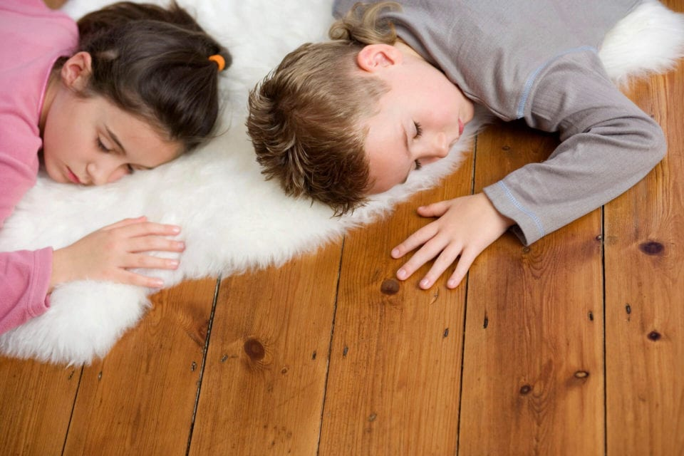 kids lying on floor