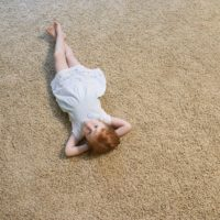 girl lying on carpet
