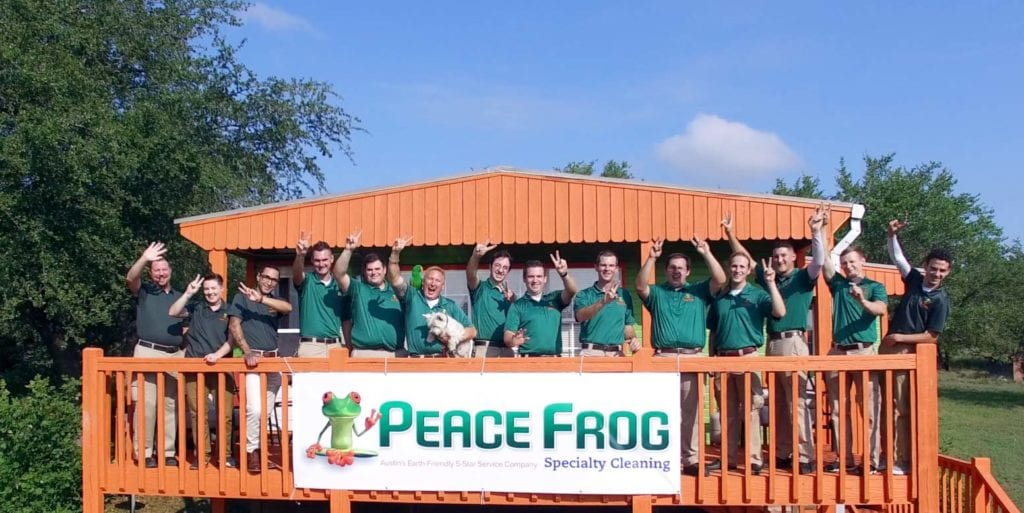 Peace Frog crew on wooden deck
