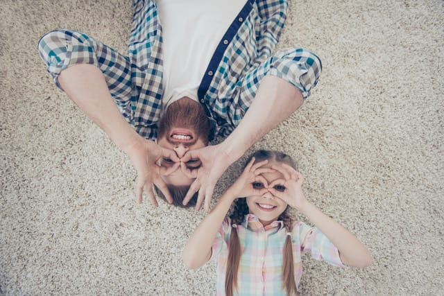 dad and daughter being silly on carpet